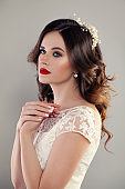 eauty Portrait of Bride with Curly Hair, Perfect Makeup and Jewelry. Red Lips, Curly and Lace