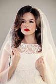 Perfect Fiancee Woman with Beautiful Hairstyle, Make up, Veil and Jewelry. Beautiful Bride