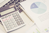 BUSINESS FINANCIAL CHART ANALYSIS WITH CALCULATOR CONCEPT