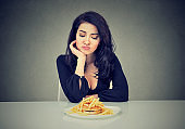 Sad woman on diet craving for fast food