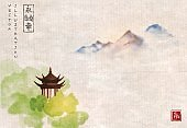 Pagoda temple in green forest trees and far blue mountains on vintage on rice paper background. Traditional oriental ink painting sumi-e, u-sin, go-hua.