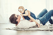 Father and daughter family happy together at home