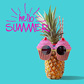 Summer and Holiday concept.Hipster Pineapple Fashion Accessories and Fruits on blue and hello summer word background