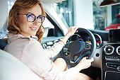 Joyful woman sitting on the passenger seat