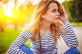 Beautiful blonde woman in the park on a sunny summer day