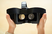 Virtual reality headset in woman hands