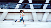 Young woman jogging on the street