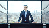 Businessman standing in front of desk