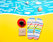 Summertime flip-flops and coffee cup