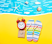 Summertime flip-flops and alarm clock with gift