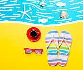 Summertime flip-flops and coffee cup with sunglasses