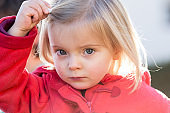 serious thinking or sad young baby caucasian blonde real people girl close portrait outdoor