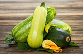 Fresh zucchini on the wooden table