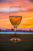 sunset with glass of wine