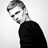 Elegant stylish handsome man. Black-white studio fashion portrait.
