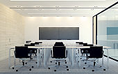 Modern interior of business conference room with blank monitor screen