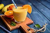 Fresh mandarin smoothie with banana and yoghurt