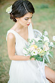 Portrait of a fresh and lovely bride with flower