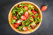 Summer salad with strawberries and greens