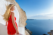 Beauty of Santorini & pretty young woman