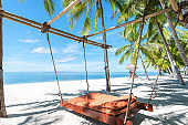 Tropical beach hanging bed relaxation