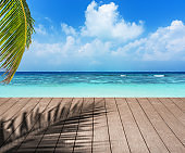 Wooden platform and tropical sea background