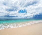 Dramatic sky and sandy beach