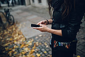 young woman texting a message in Berlin Prenzlauer Berg