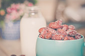 almonds  with milk on table. Selective focus, shallow DOF