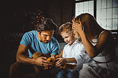 Family home portrait. Parents and son spending time together