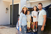 Portrait Of Family Packing Car Ready For Summer Vacation