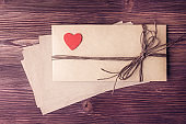 Flat lay of tied envelop for Valentine's day over old wooden background