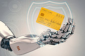 robot hand holding credit card
