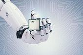 robot hand holding cpu chip