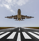 Airplane landing on a sunny day