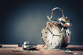late for work concept with destroyed alarm clock