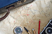 Travel plan abstract concept with old maps suitcase and camera