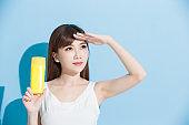 woman take sunscreen