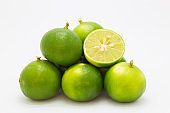Fresh limes fruit on white background