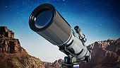 A telescope standing at the desert with night sky in the background. Astronomy and stars observing concept.