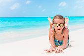 Little girl on the white beach