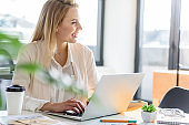 Smiling stylish girl working cheerfully at office