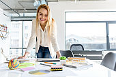 Successful girl working with pleasure at creative big office