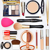 Make up products on wooden background