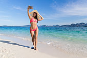 Young Woman On Beach Taking Selfie Photo On Cell Smart Phone Summer Vacation, Beautiful Girl Seaside
