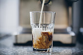 Ice coffee in a tall glass