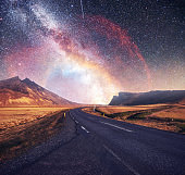 Fantastic starry sky and majestic mountains in the mist. Dramatic  beautiful morning. Autumn landscape. Courtesy of NASA