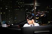 A businessman sleeping at a company
