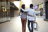 Young couple shopping in city street