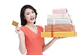 Cheerful young woman with bank card shopping